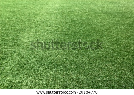 Artificial grassy covering, green background - stock photo
