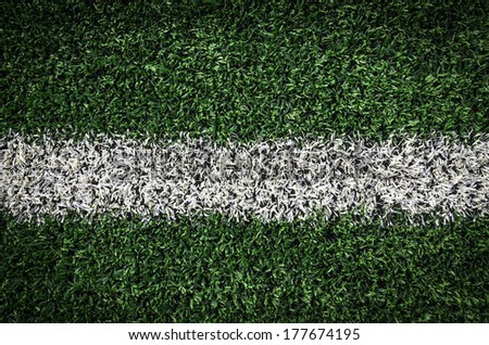 Artificial green turf texture background with white line mark - stock photo