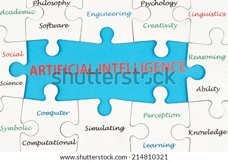 Artificial intelligence concept word cloud on group of jigsaw puzzle pieces - stock photo