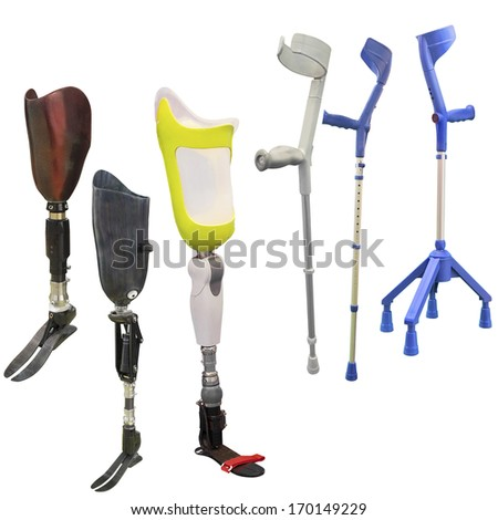artificial limbs and invalid walking sticks under the light background - stock photo