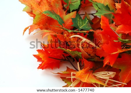 Artificial maple leafs and corn -  Thanksgiving decoration - stock photo