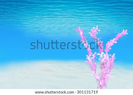 artificial pink marine plant with under the sea background - stock photo