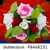 Artificial roses. Bouquet of artificial roses with a red background. - stock photo