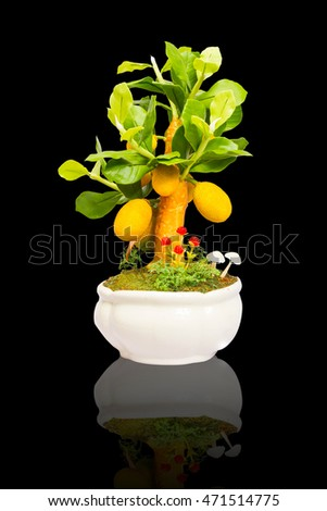 Artificial sculpture jack fruit tree isolated on black background with clipping path