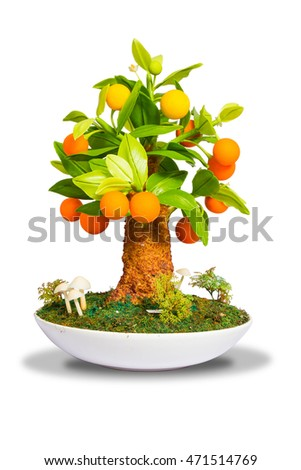 Artificial sculpture orange trees isolated on white background with clipping paths