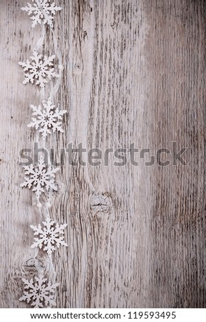 Artificial snowflakes on wooden background - stock photo