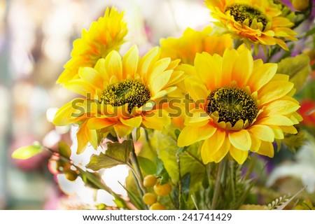 artificial sun flower bouquet - stock photo