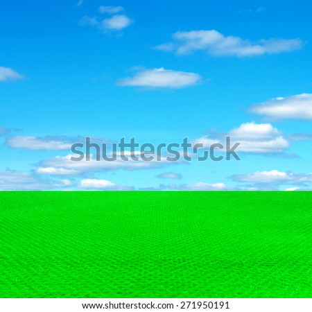 artificial turf on the sky background - stock photo