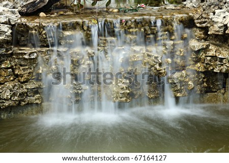 Artificial Waterfall - stock photo