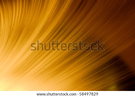 Artificial waterfall at night back lit by orange light. - stock photo