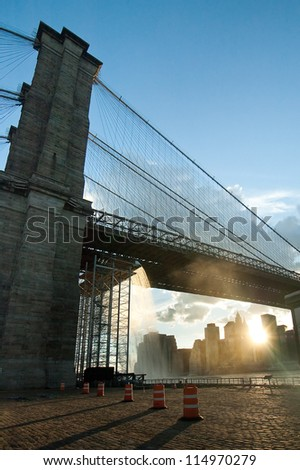 Artificial Waterfalls under Brooklyn Bridge in New York City, USA. vertical composition. - stock photo