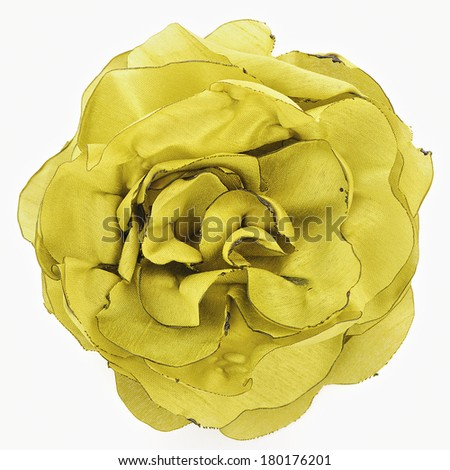 Artificial yellow flower of silk isolated on white background - stock photo