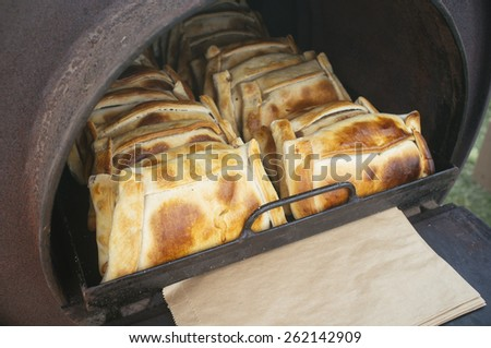 Artisan baked with classic chilean breaded meat. - stock photo