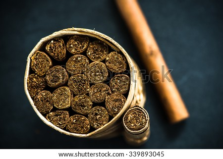 artisan box of cuban cigars from above, copy space background - stock photo