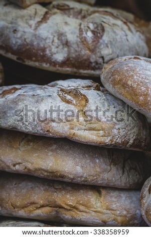 artisan bread in ancient medieval fair, Spain - stock photo