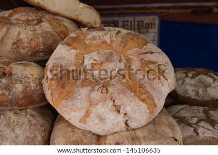 Artisan loaves medieval fair market - stock photo