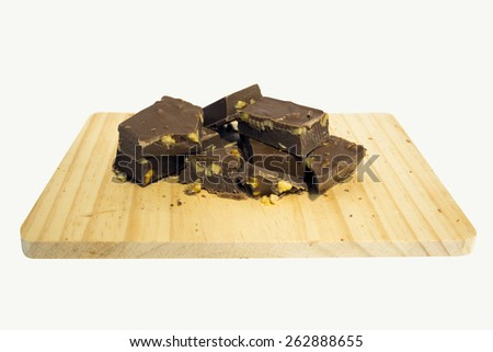Artisanal chocolate with nuts chunks isolated on white background - stock photo