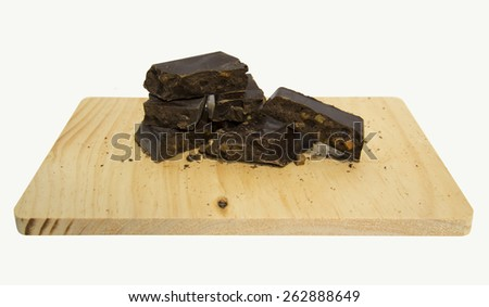 Artisanal chocolate with orange chunks isolated on white background - stock photo