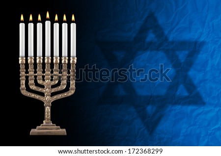 artisanall lit hanukkah menorah and David' star on black background.  - stock photo
