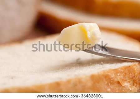 artisinal crusty bread with rosemary and garlic baked plus butter - stock photo