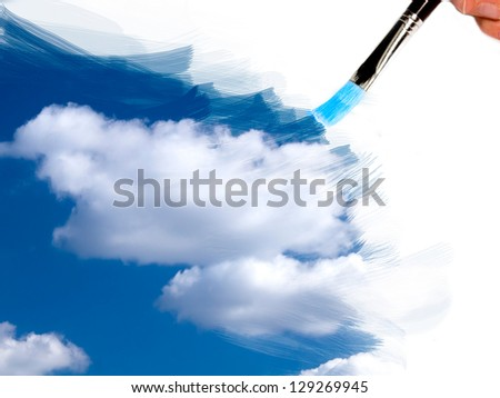 artist brush painting sky and clouds - stock photo