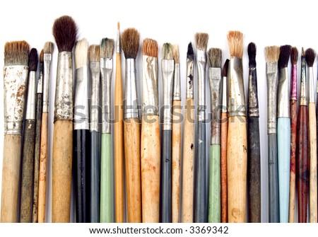 Artist brushes isolated on white - stock photo