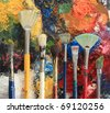 Artist brushes on an oil painting background. - stock photo