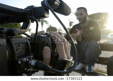 Artist & Cameraman Filming Creative Video Footage In Daylight - stock photo