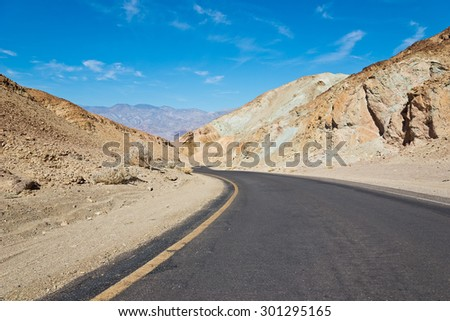 Artist drive turns into a narrow and winding road. Dry and hot, the drive is Located in Death Valley, California.  - stock photo