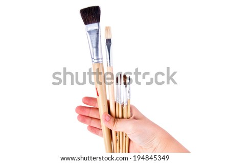Artist Hand Holding Variety Mixed Size of Paintbrush Brush Ready to Paint in Art Work Concept and Idea isolated on white background.