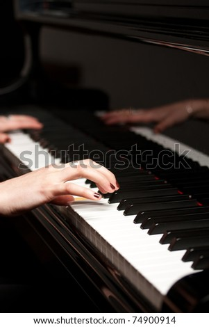 artist hands of a piano player - stock photo