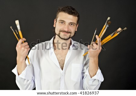 artist in a white shirt with tassels - stock photo