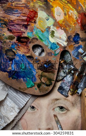 artist oil  brushes, paints and  Artists oil paints and brush multicolored closeup - stock photo