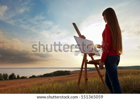 artist painting an sea landscape - stock photo