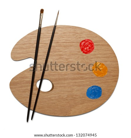 Artist painting palette with two sable brushes with red, yellow and blue paint on white background. - stock photo