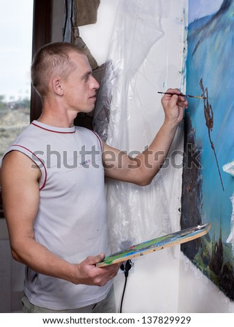 artist paints oil painting on the wall. oil painting on the wall.