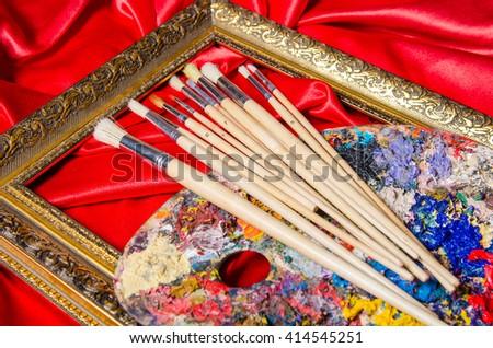 Artist palette in art concept - stock photo