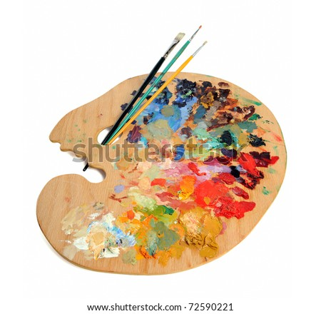 Artist palette with paintbrushes over white background - stock photo