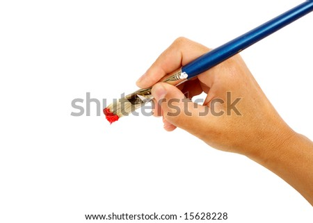 artist poised and ready for work, focus on brush - stock photo