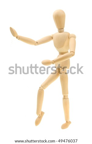 Artist's dummy in a martial arts pose isolated on white
