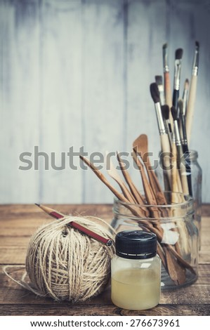 Artist's painting and sculpturing tools. Art and craft. Wooden background. Selective focus. - stock photo