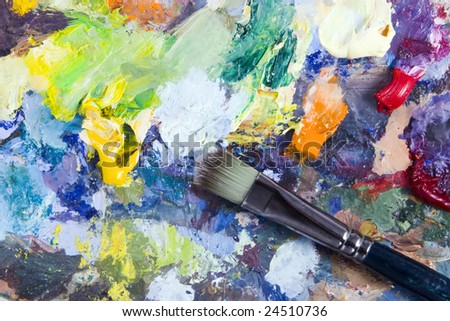 Artist's palette with multiple colors and brush