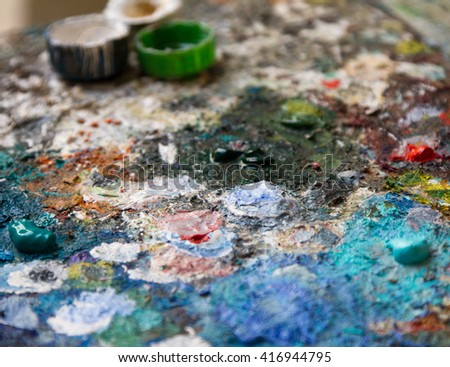 artist's palette with oil paints. Blurred abstract artistic background - stock photo