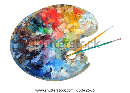 Artist's palette with paintbrushes isolated over white background - With clipping path - stock photo