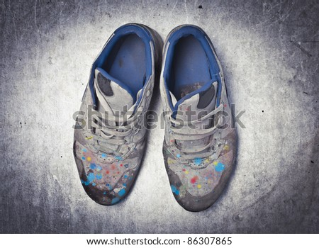 Artist's shoes full of paint blots