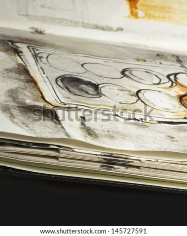 artist�´s sketchbook with sketches in it, detail, copyspace - stock photo