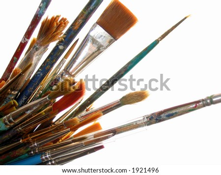 Artist's well used paintbrushes - stock photo