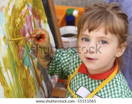 artist school little girl painting brush watercolors portrait - stock photo