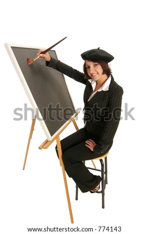 artist starting with a blank canvas on an easel as she prepares to create - stock photo