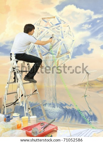 artist with an airbrush painting the walls. concept of Clean Energy